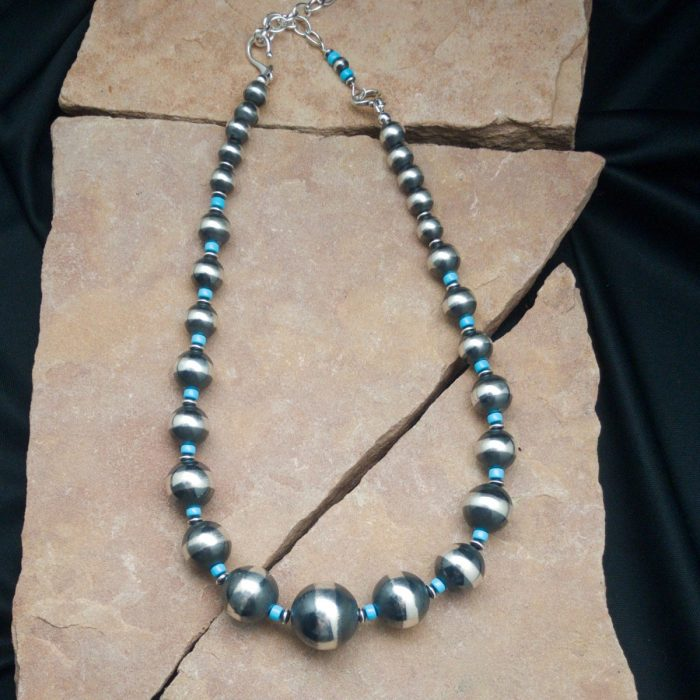 Navajo Pearls are made of sterling silvere-american-jewelry/our-native-american-silver-chains-are-authentic-and-genuine/sws-103-authentic-sterling-silver-round-saucer-bead-necklace/